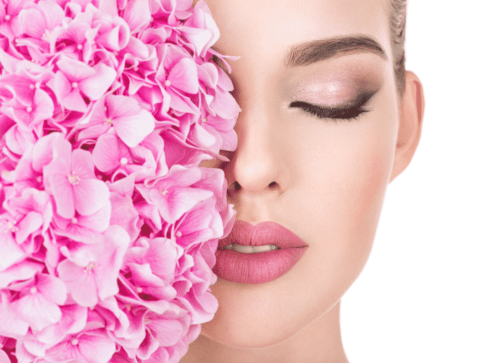 young-beautiful-woman-with-flowers-near-face 700x